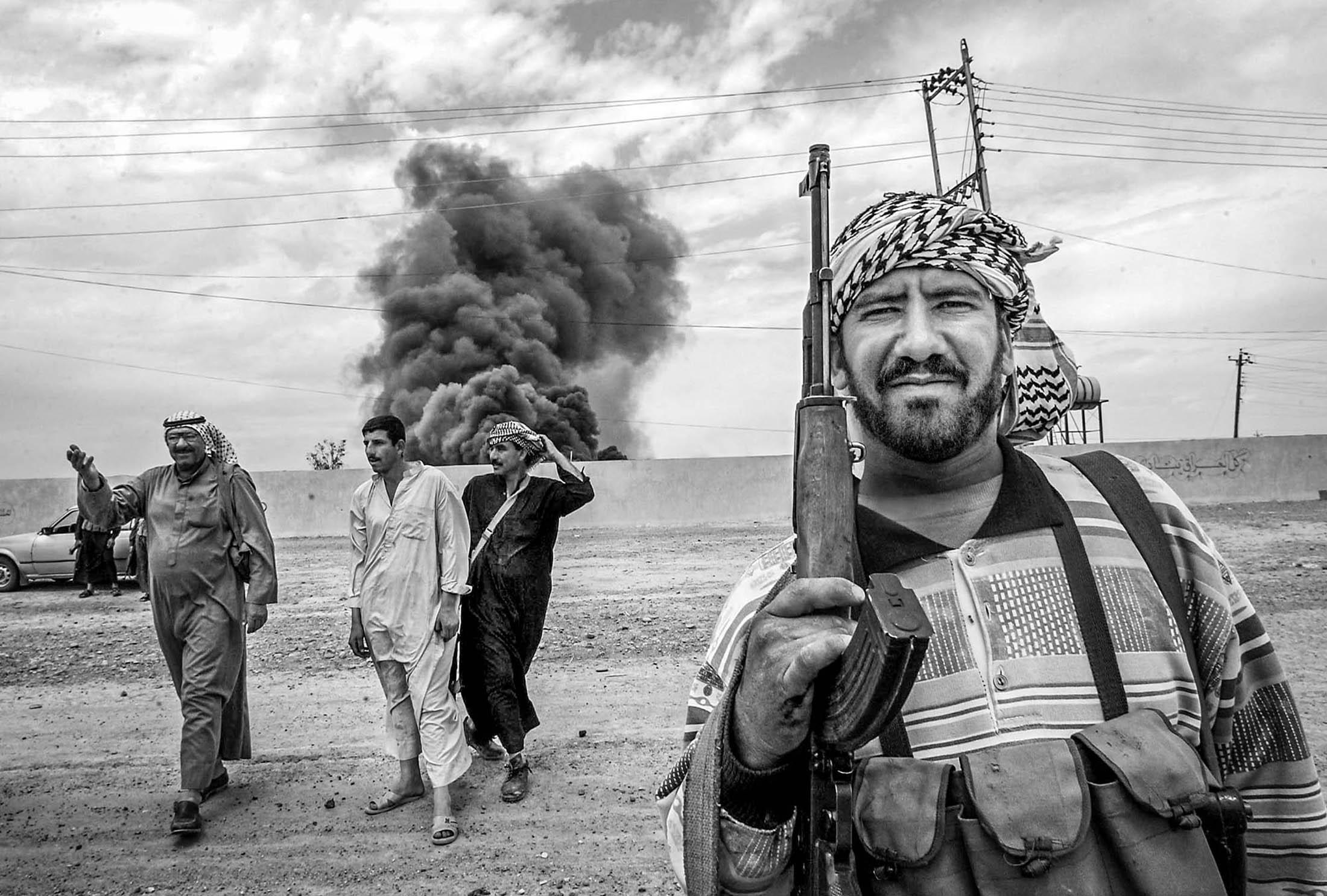 As the forces of Saddam Hussein retreat, Arab villagers near Kirkuk armed themselves, afraid of retaliation by the majority Kurds. Under Saddam Hussein's regime, Arabs were intentionally resettled in order to control Kirkuk an important city with a large oil field.