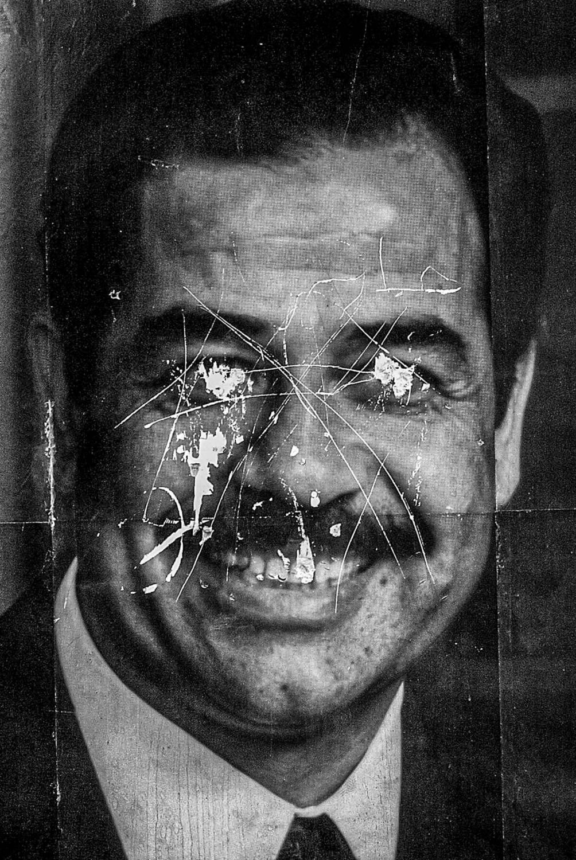 Disfigured portrait of Saddam Hussein in the City of Kirkuk.
