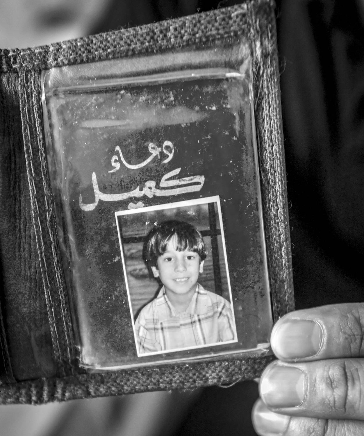 Abdullah's father keeps a photo of Abdullah taken before he was injured.