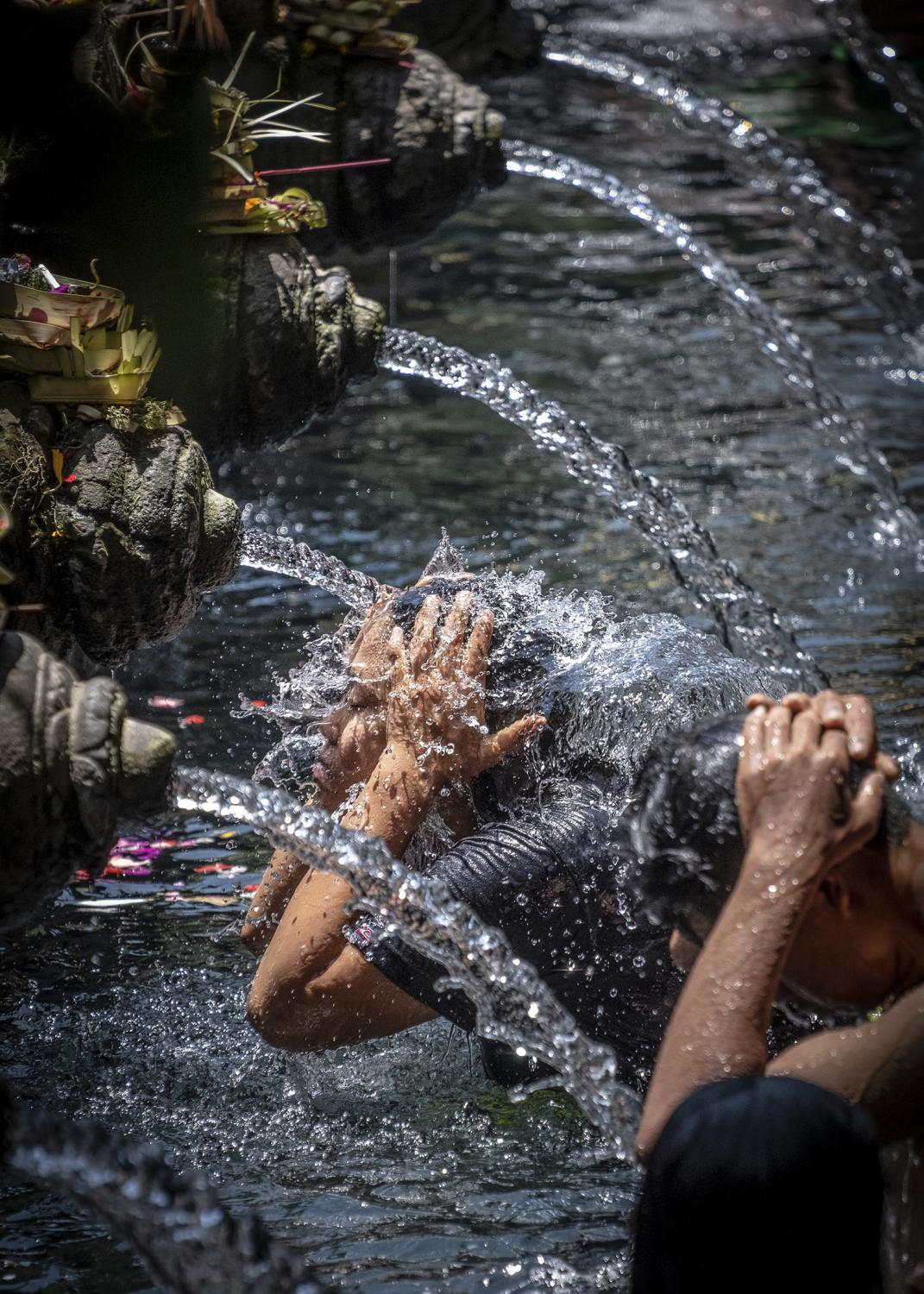 Worshipers bathe at Tirta Empul Temple in Bali, Indonesia.