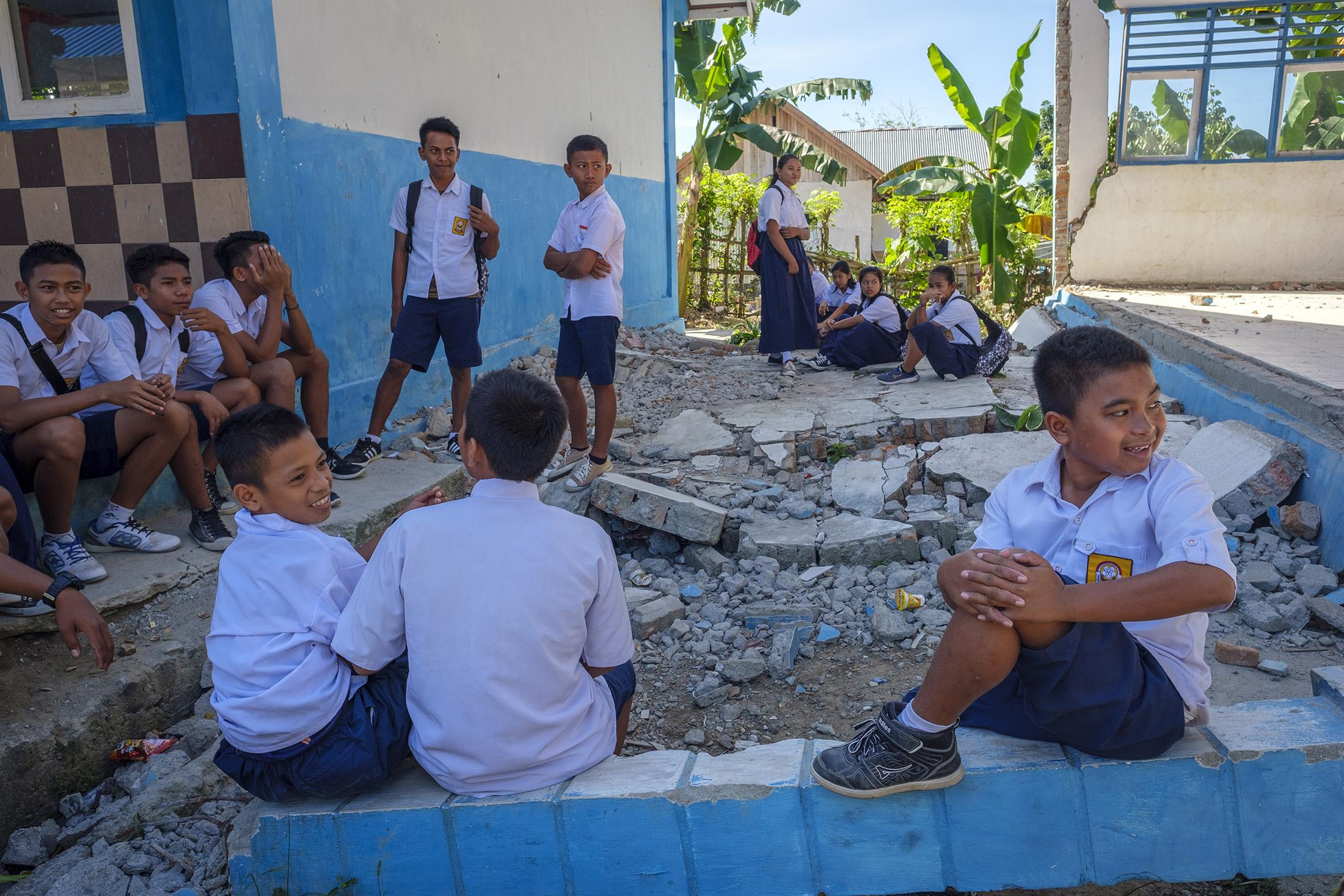 Recess at a damaged public elementary school supported by Save the Children in Donggala region, Central Sulawesi, Indonesia, February 25,  2019. A replacement school was built next door.