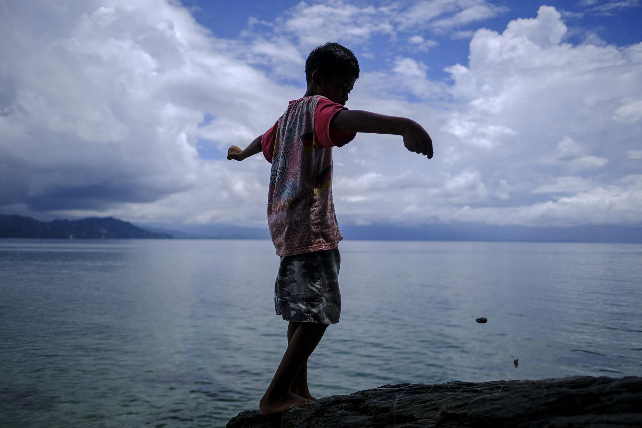 Children play after school in Village of in Donggala region, Central Sulawesi, Indonesia February   25,  2019 . People in Indonesia, the world's largest island country, with more than seventeen thousand islands, have a long and intimate history with ocean.