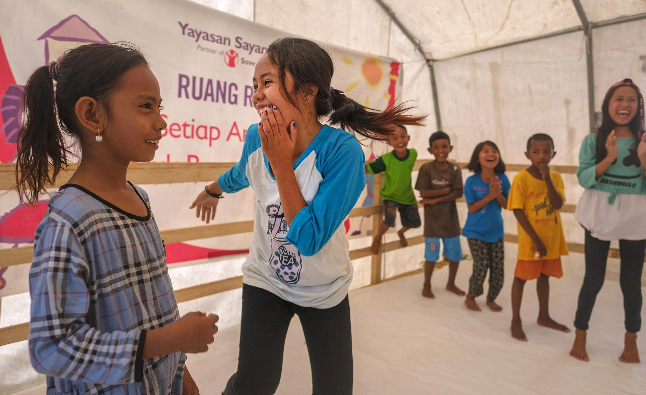 Marzela, 12, engages in a game play at a Child Friendly Space built and run by Save the Children in Donggala region, Central Sulawesi, Indonesia, . Their house was destroyed during the  2018 earthquake.