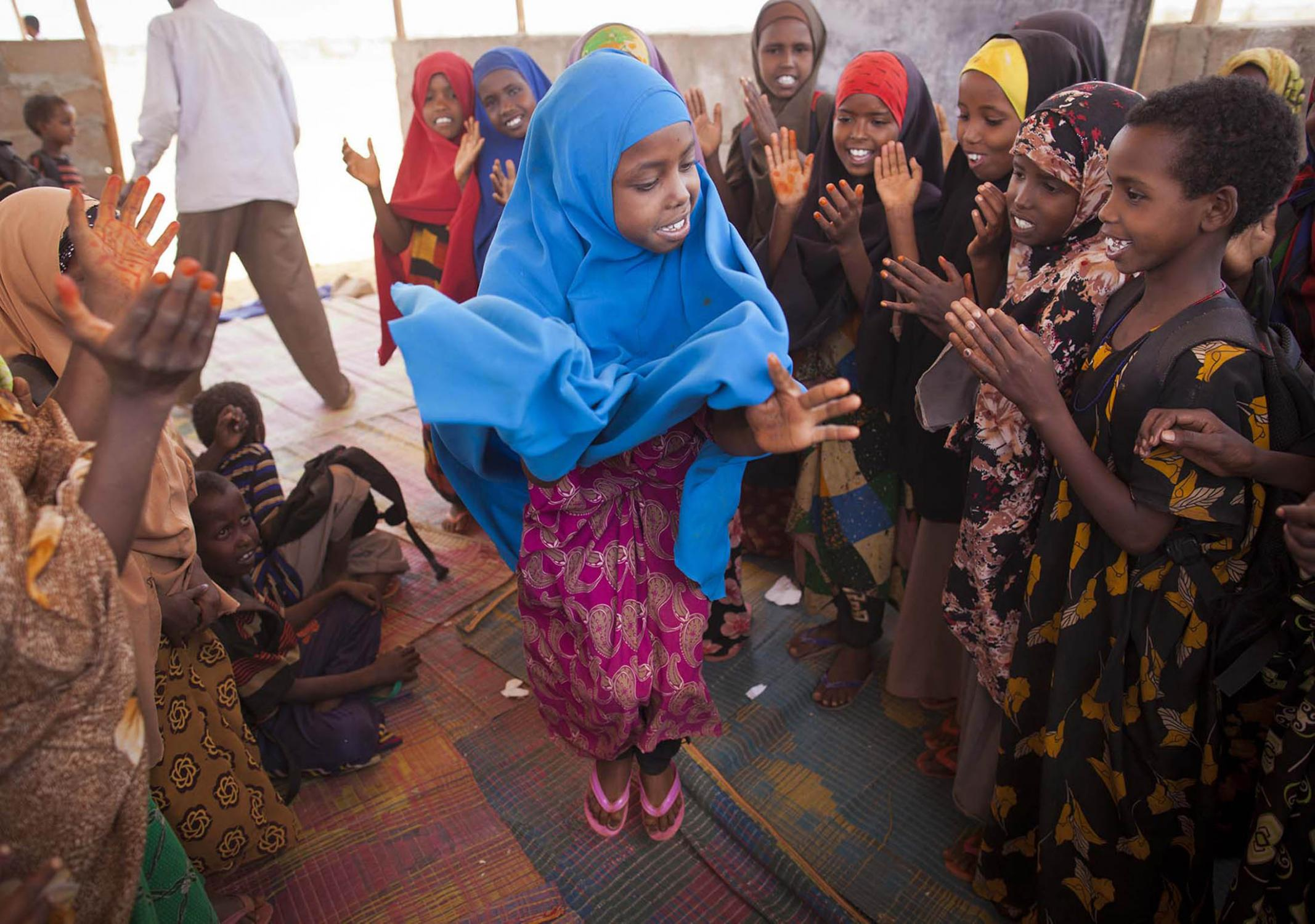 Children engage in a traditional song and dance at Buramino Refugee Camp in Dolo Ado in Ethiopia, March 8, 2012.