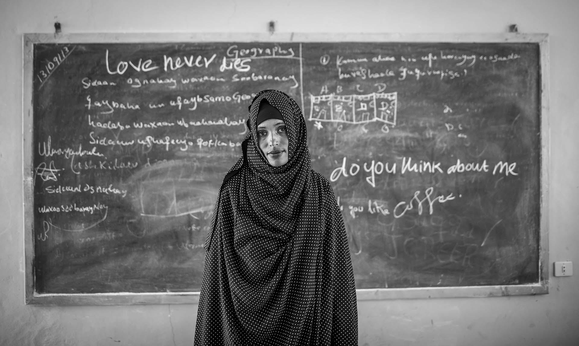 Somali refugee Nemha poses for a photo in a classroom at the secondary school in Sheder Refugee Camp in Somali region of Ethiopia, 16 September 2013. All her family members were dead and she lives with other females in a camp.