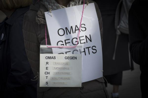 Omas Gegen Rechts (Graniies against the Right) show what they stand for at the vigil at Alexanderplaty in Berlin, Germany.