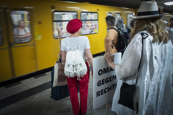 Omas Gegen Rechts take the U Bahn at Hallesches Tor  in Berlin bound for Alexanderplatz for the monthly 'Mahnwache'-Vigil.