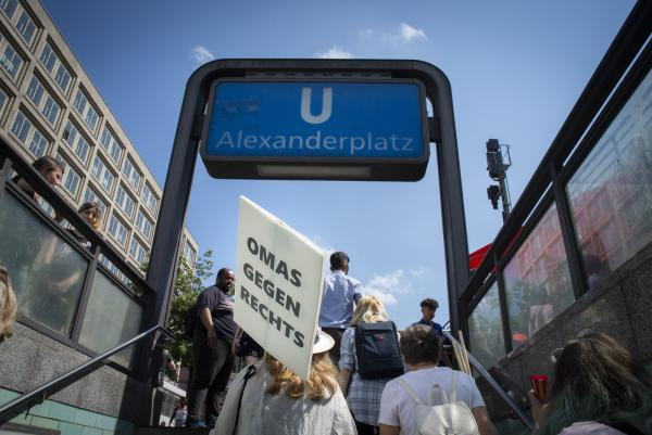 Leaving the U Bahn as Omas Gegen Rechts make their way to hold their hour long Vigil (Mahnwache in Deutsch) once a month at Alexanderplatz in Berlin, Germany.