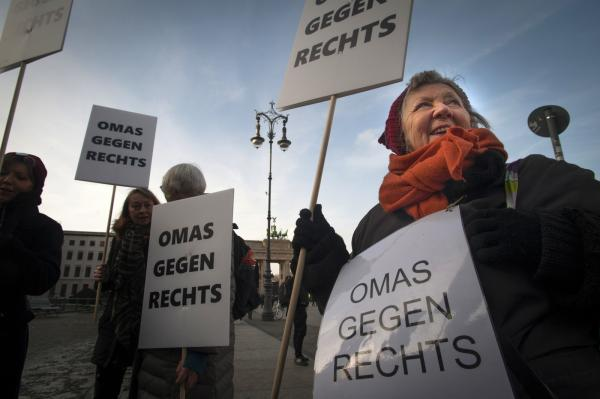 Omas Gegen Rechts (Grannies against the Right) meet at the Branderburg Gate in Berlin, Germany.