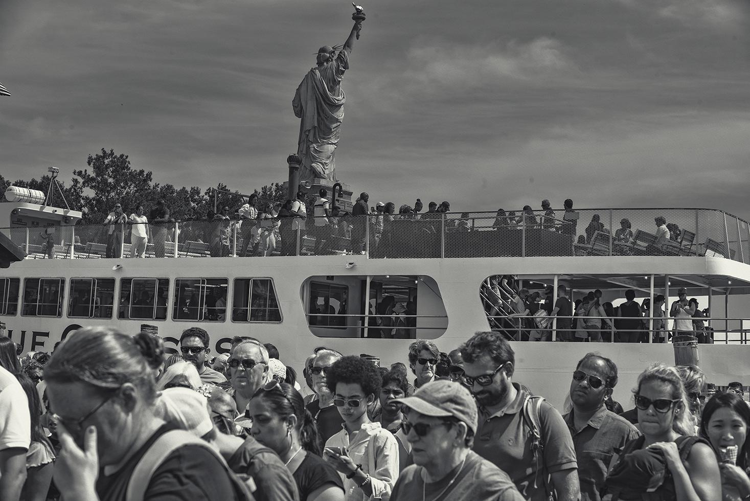 """Lady Liberty"" welcomes the ""Masses"" coming by ferry to Statue of Liberty National Park, NYC.August 2019."