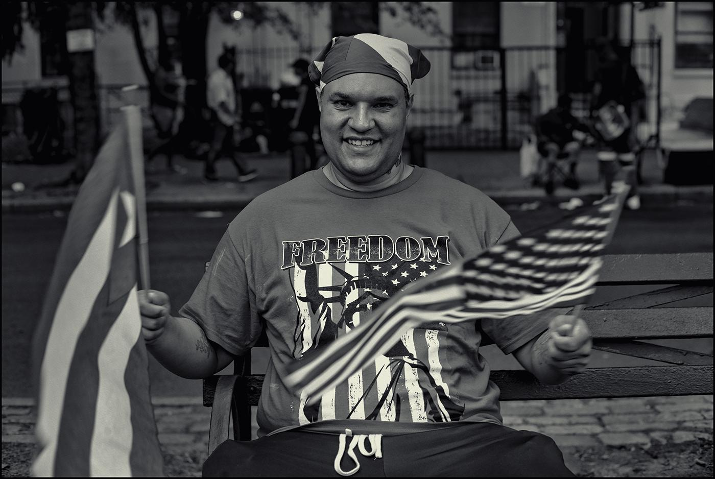 """Sly"" with is Puerto Rico & USA flags,West Indian American Day celebrations Brooklyn,NYC.September 2019."