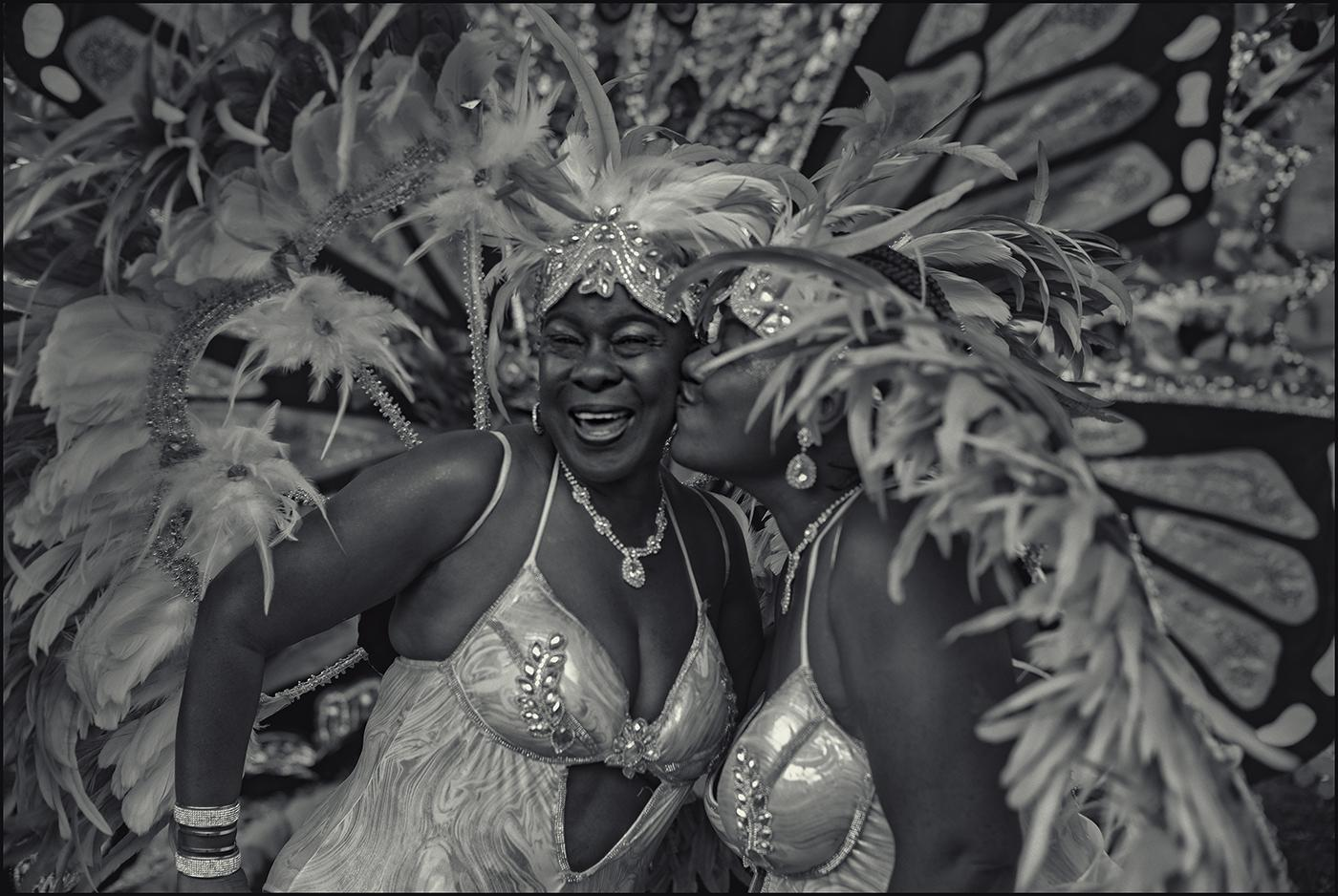 """Marvelous Marva (left) is kissed by fellow dancer Kim prior to start of West Indian American Day celebrations, Brooklyn, NYC.September 2019."