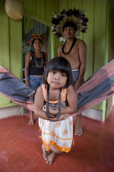 "4 year old Soeytxer Surui with her father and mother at home in Lapetanha, Rondonia, Brazil at the ""7th September Indian Reserve""."