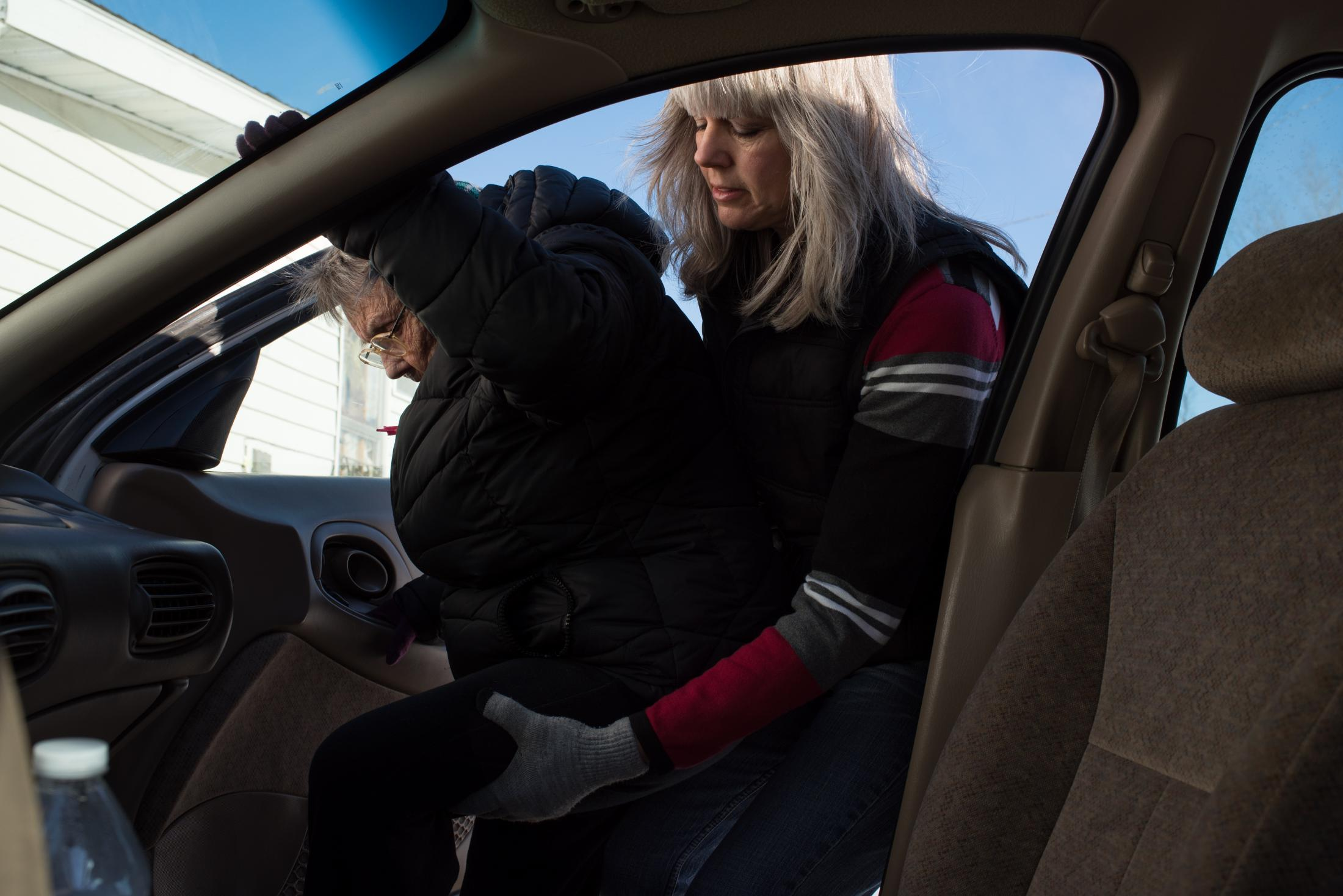 Roxanne Rupe, Coolville's librarian, helps her mother-in-law,  Mary Rupe, into Roxanne's vehicle in February 2015. Mary would go on to spend the afternoon with her son so that she wouldn't be alone at her own house.