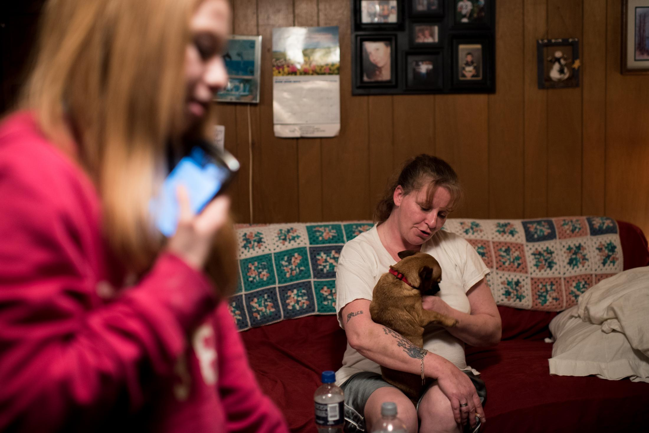 Mother, daughter, and the family dog in Coolville, Ohio.