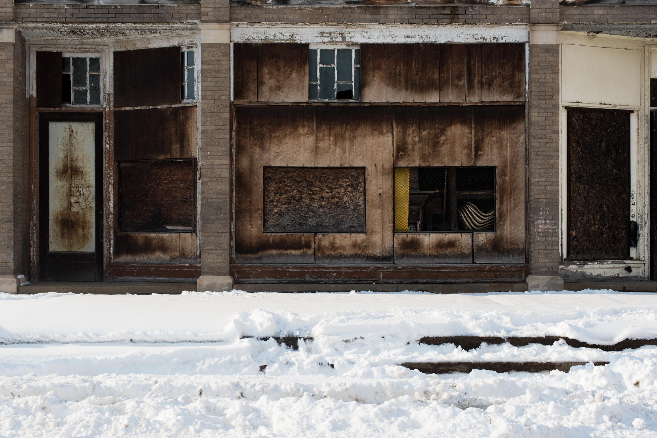 The closed storefront of a space that was once a family owned grocery store on Main Street in Coolville.