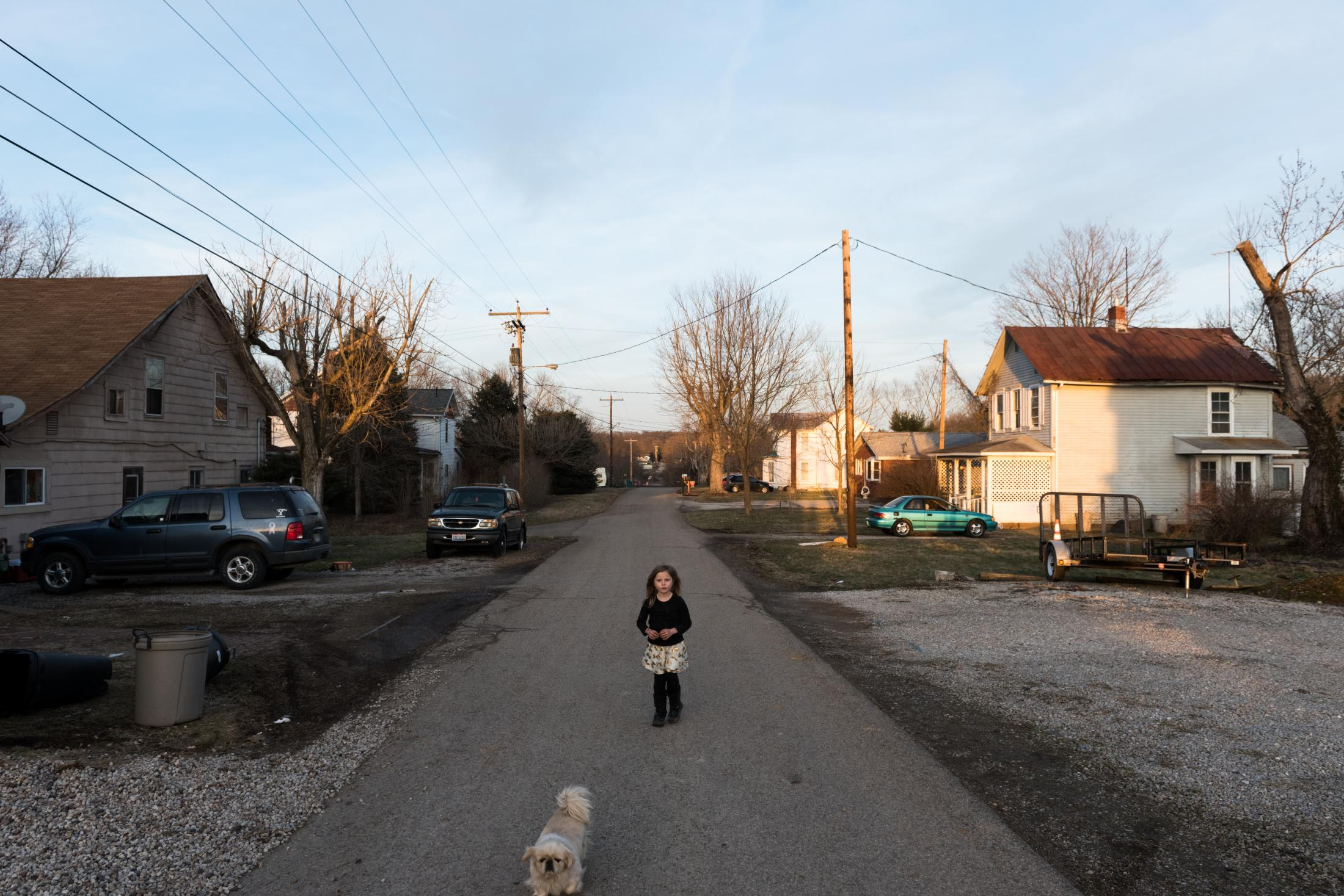 Chloe Harris, 6, walks down the street on a February afternoon in Coolville, Ohio.