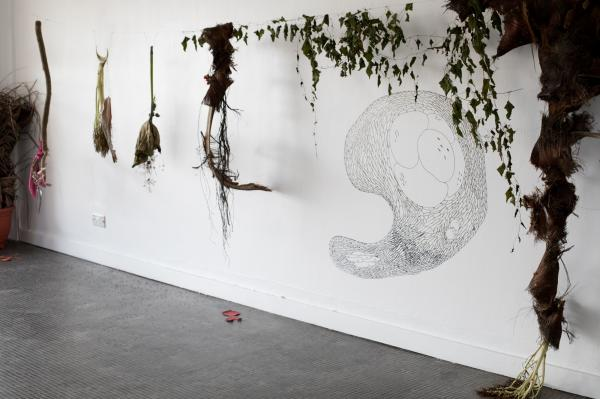 """A Walk"" sculptures made in situ from palm husks, leaves, sticks, blossoms, torn material and seeds, gathered from walks in Yaba, Lagos, as part of a 11 day walk installation at Treehouse Lagos, 2018. Drawings of ""plant cells/ plant spirits"" were made on the walls."