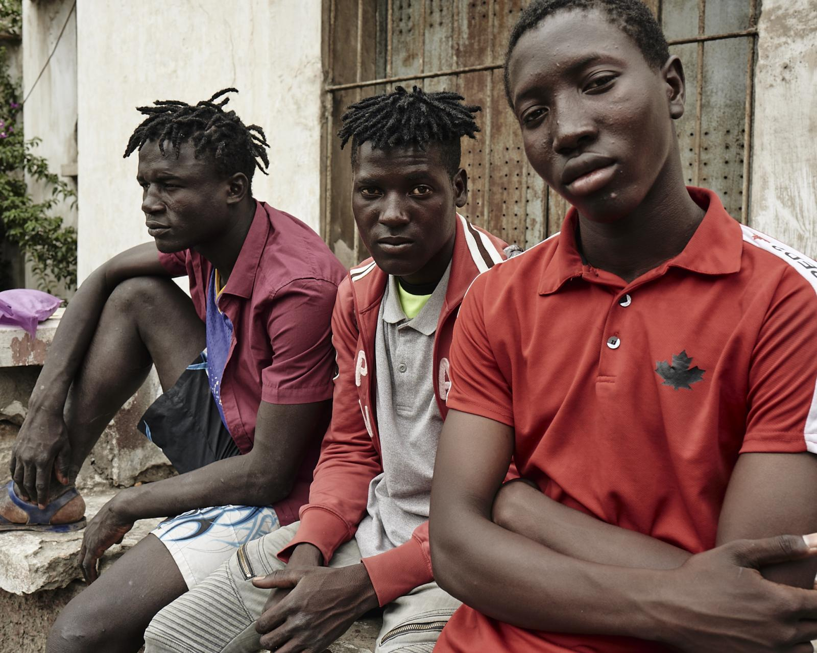 A group of teenagers poses for a portrait.