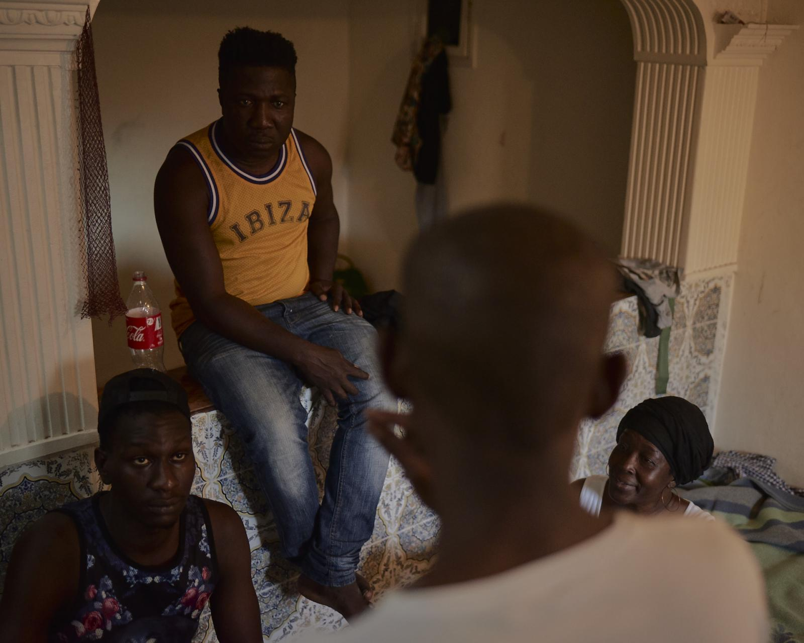 A meeting inside an apartment rented illegally for migrants, where they pay around $300 euros each. Since they can't work, they also can't have access to rent property or benefits. Inside this room, around 9 other people sleep on mattresses on the floor sharing only the basics.