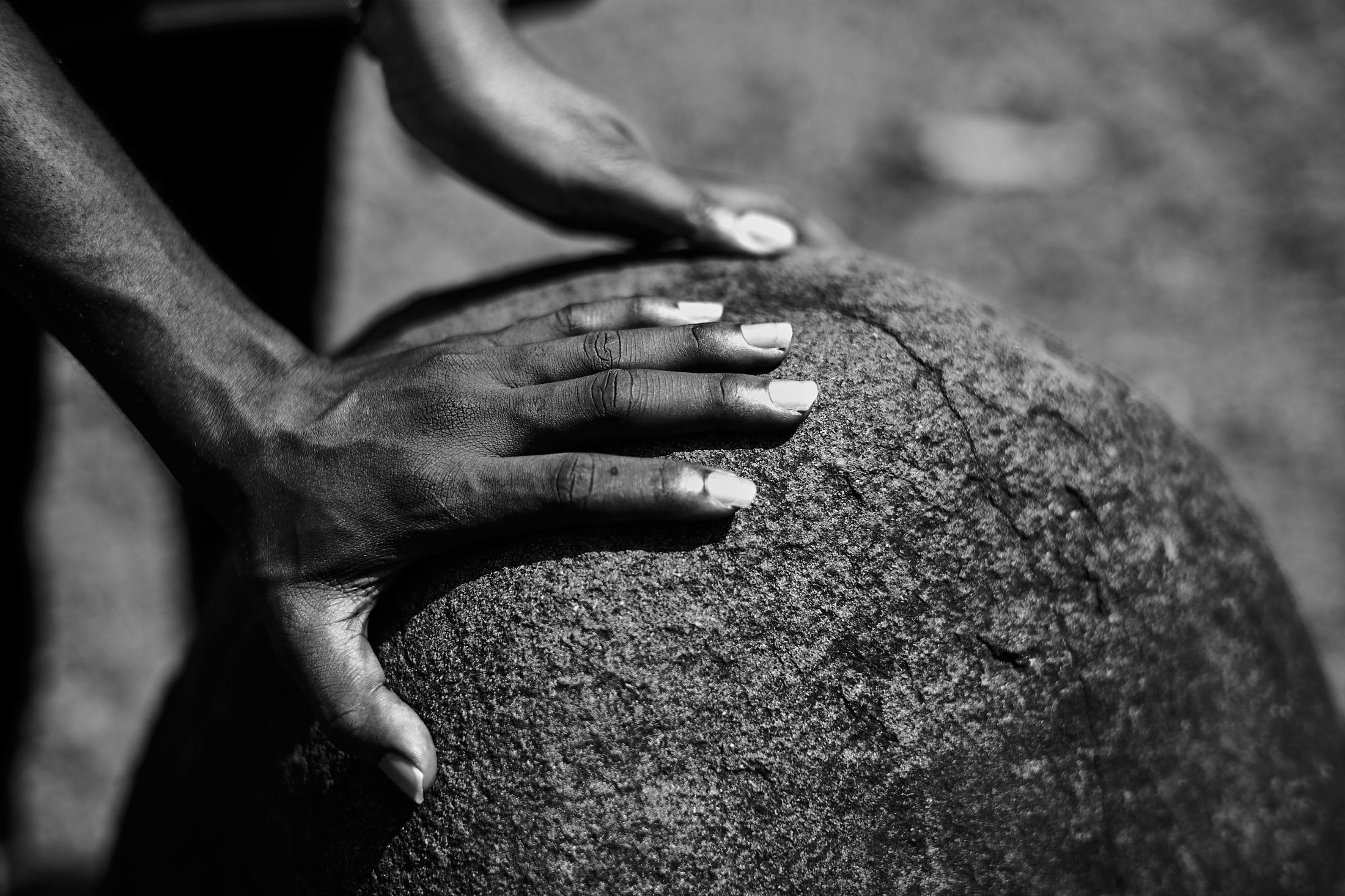 touching wisdom stone, open air monoliths museum,ikom (nigeria-cameroun border town), nigeria