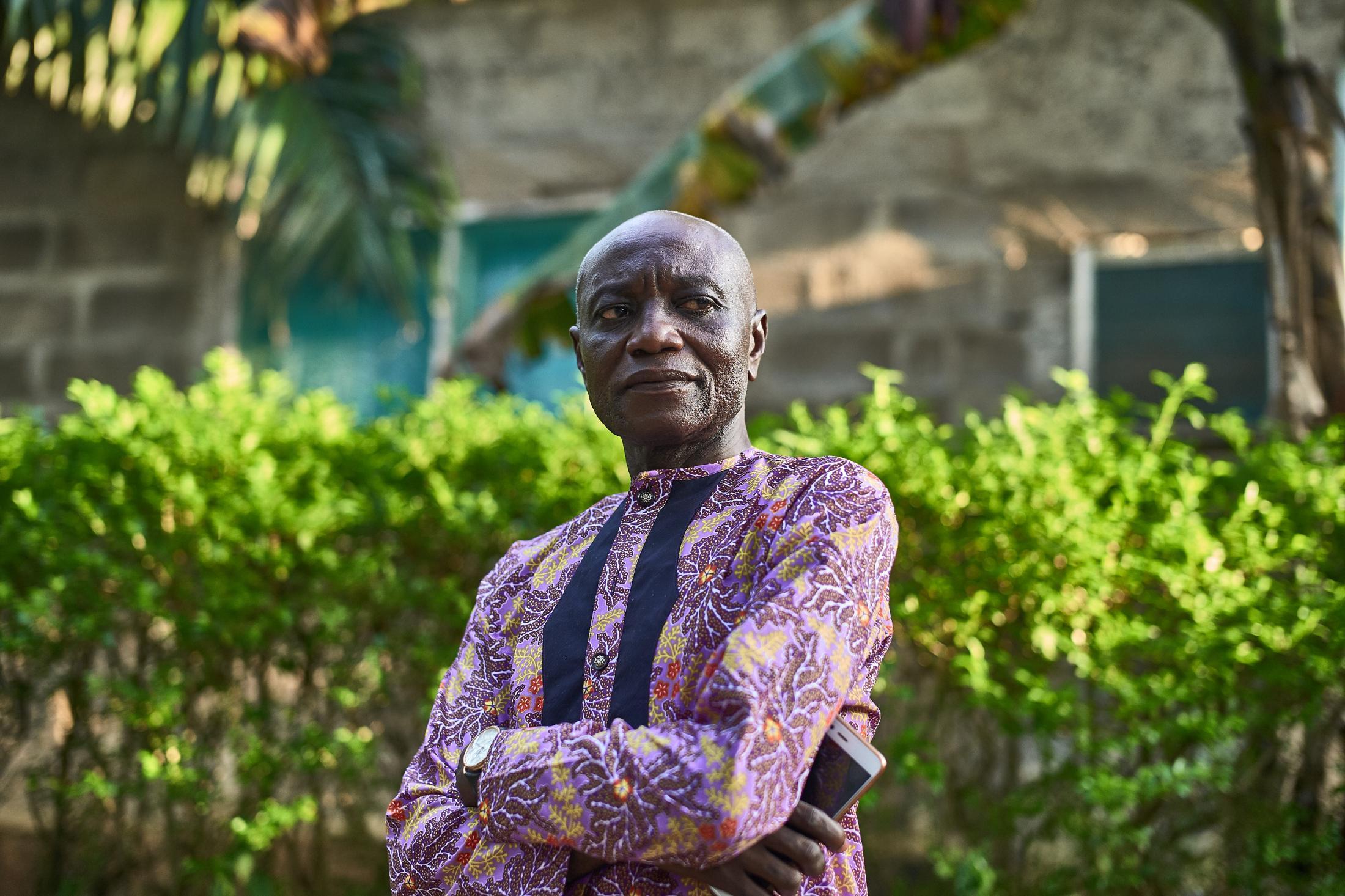 a man's worth stand beside him,ikom (nigeria-cameroun border town), nigeria.