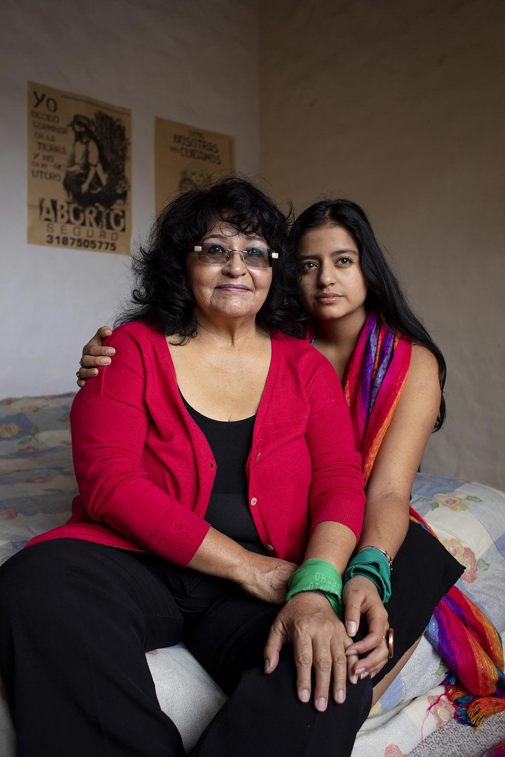 "Tamia Maldonado poses with her grandmother, Guadalupe Tobar, in her room in Quito. Tamia is a member of ""Las Comadres,"" a group of women who have come together to support other women in their decision to have an abortion. Guadalupe had two abortions when she was younger. Tamia and Guadalupe are feminists and activists for the legalization of abortion in Ecuador."