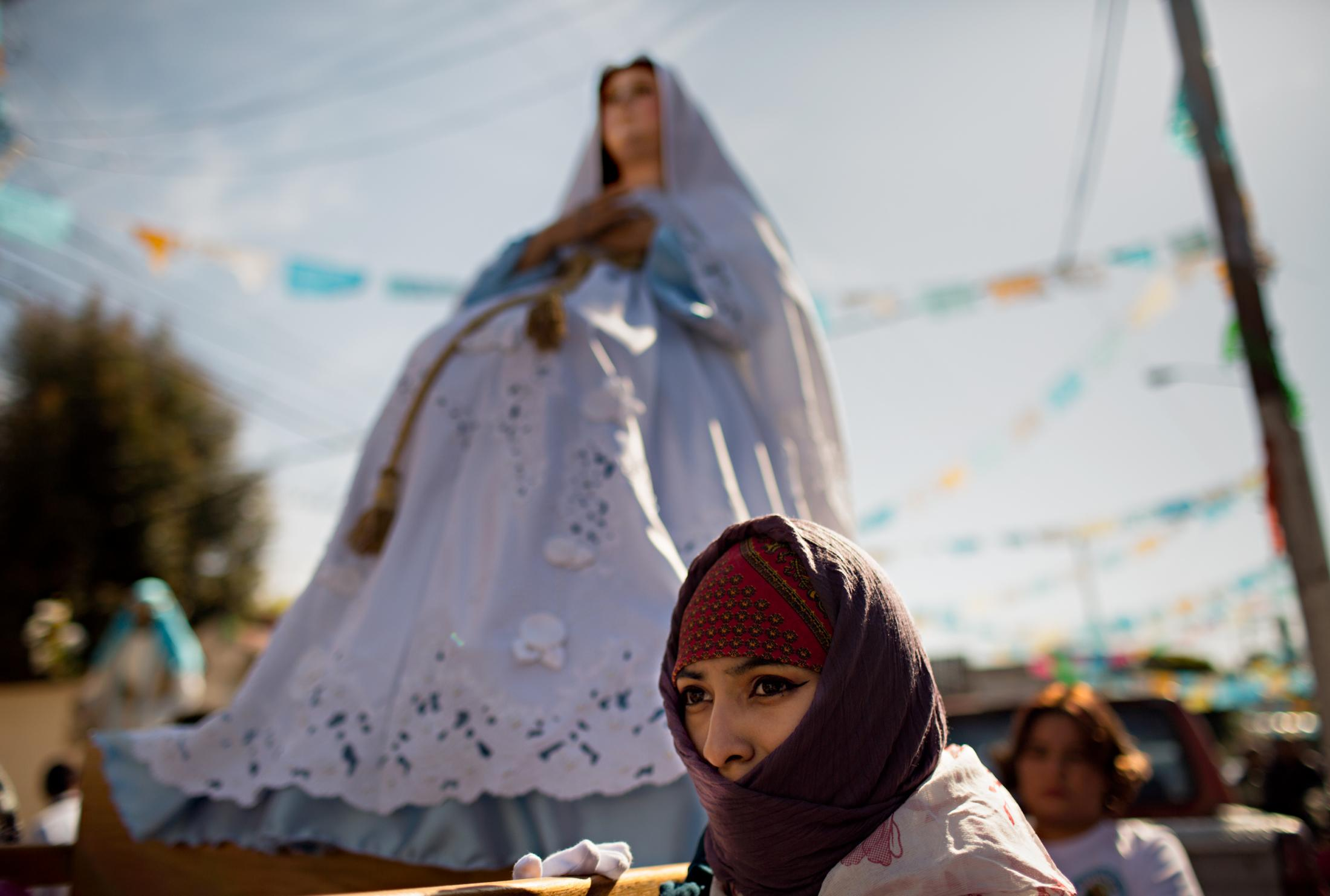 A worshiper holds a sculpture representing the Virgin Mary during the procession to the 16th Century San Bernardino de Siena Church in Xochimilco. On this day, the old 2018 Majordomo will hand the Niño to the new Majordomo.