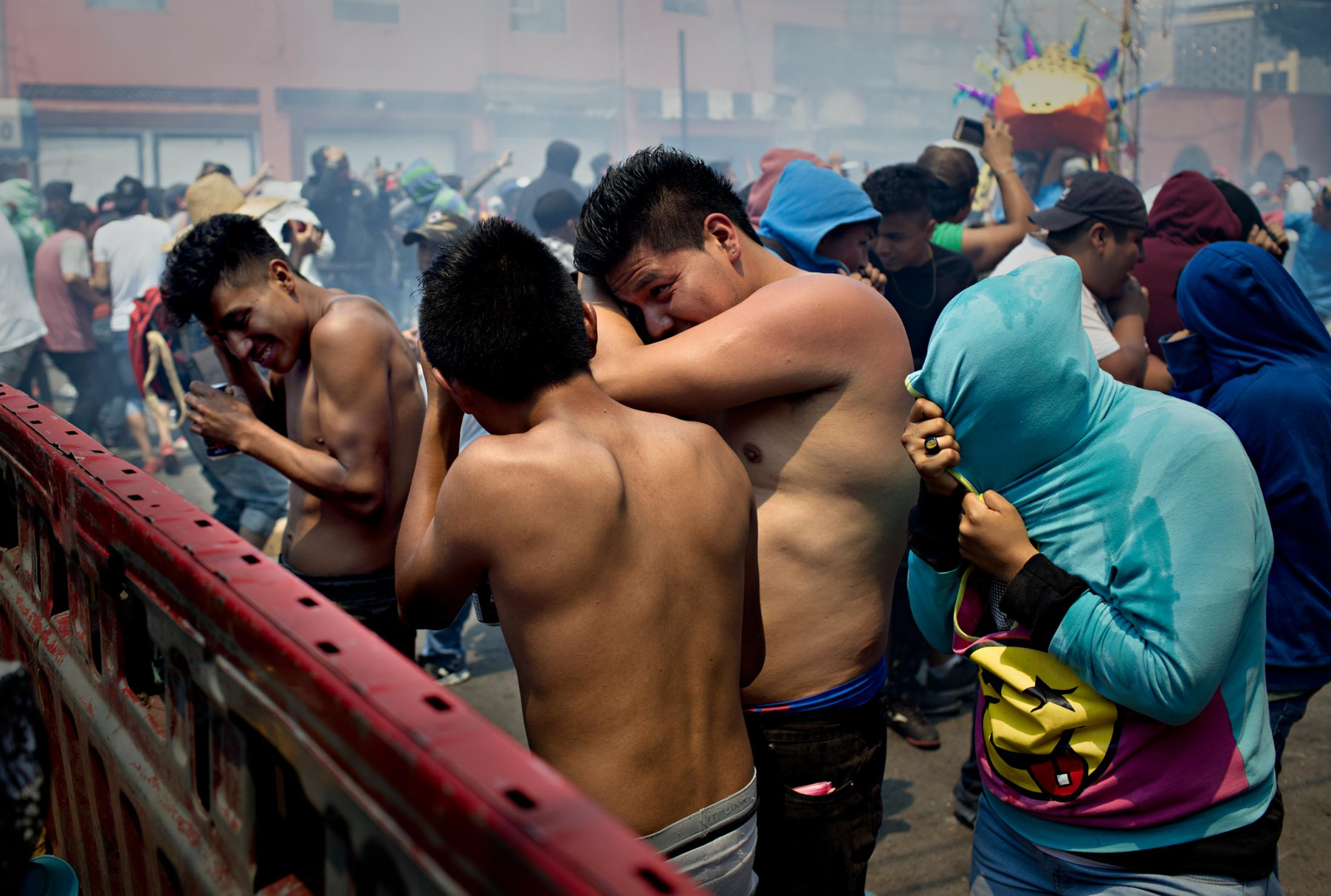 Teenagers show off their machismo by taking their shirts off during the celebration in which fireworks goes off among the crowd. Some get injured but they accept it to be the price to be paid for their masculinity.