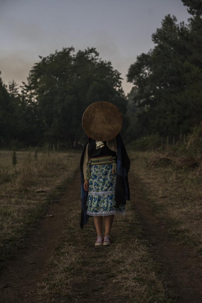 Belén Curamil(19) daughter of Alberto Curamil, Mapuche political prisoner holding a Kultrun, a Mapuche traditional musical instrument. Curacautín, Araucanía region, Chile. March 23rd, 2019