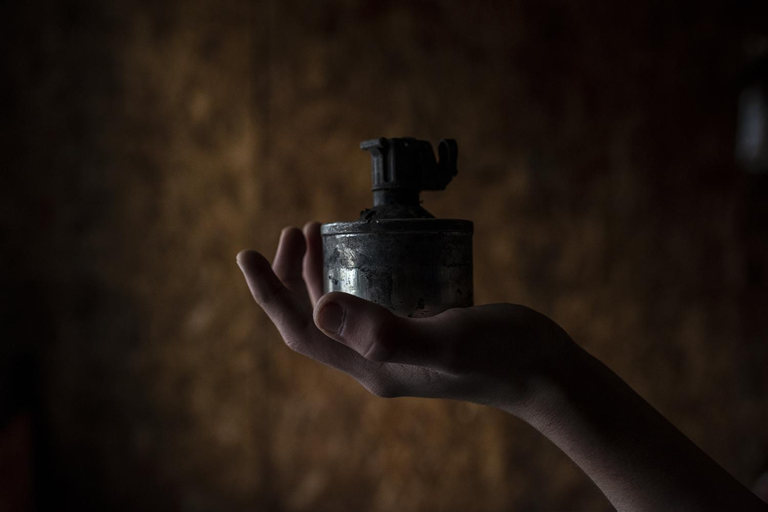 Israel Hernandez Huentecol holding a tear gas can used by riot police and found near his home. Israel's brother , Brandon, was shot by the police and he has been threatened by members of the police special forces. Curaco, Araucanía Region. Chile. 22nd, July,2019.