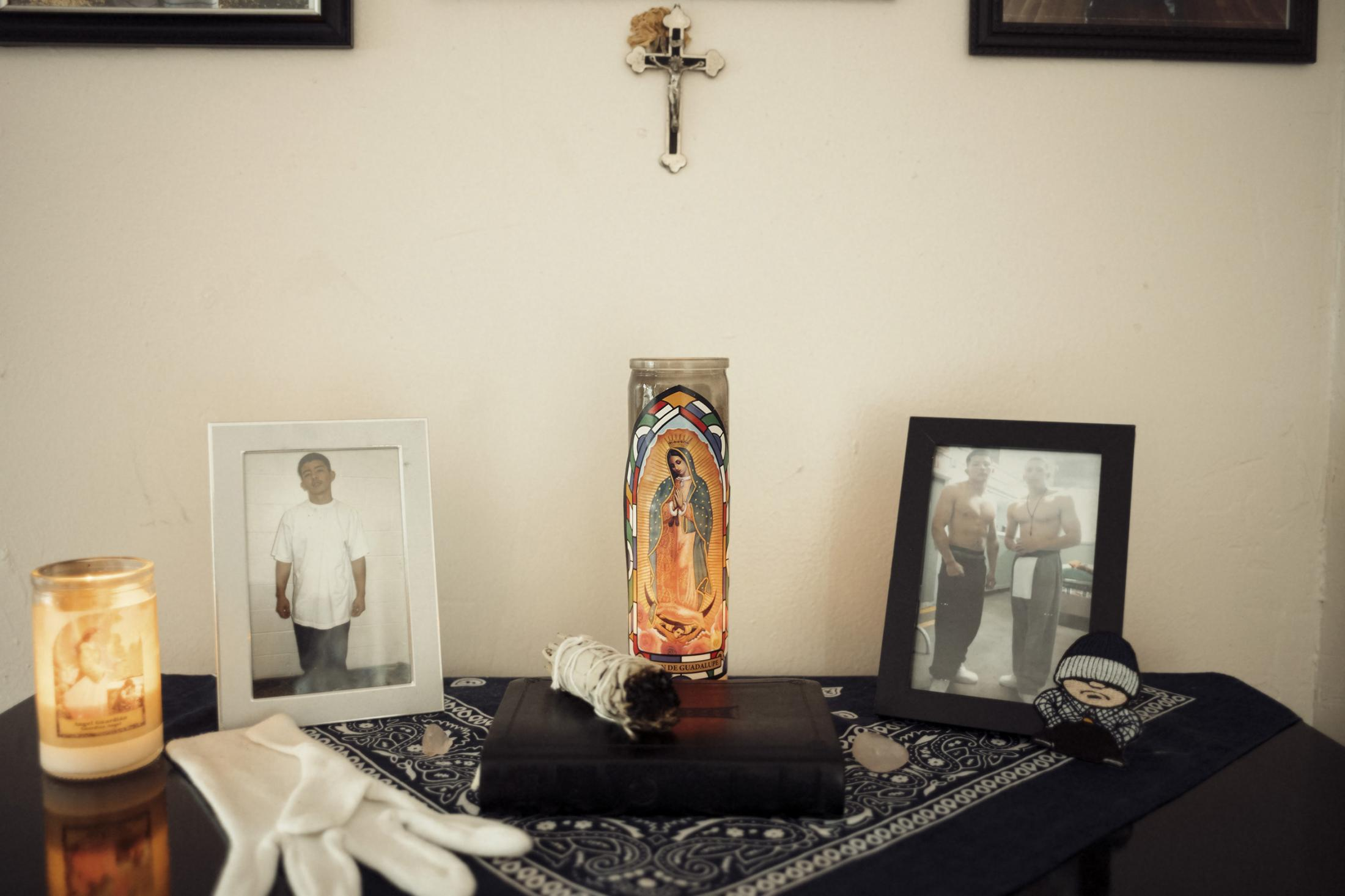 """An altar for Marcus Tapia's best friend, """"Yayo,"""" who was gunned down soon after their mutual release from California Youth Authority prison. Tapia kept the altar on the dresser of his small apartment which he shared with his girlfriend whom he believed Yayo sent him from heaven, to watch out for him in his absence."""