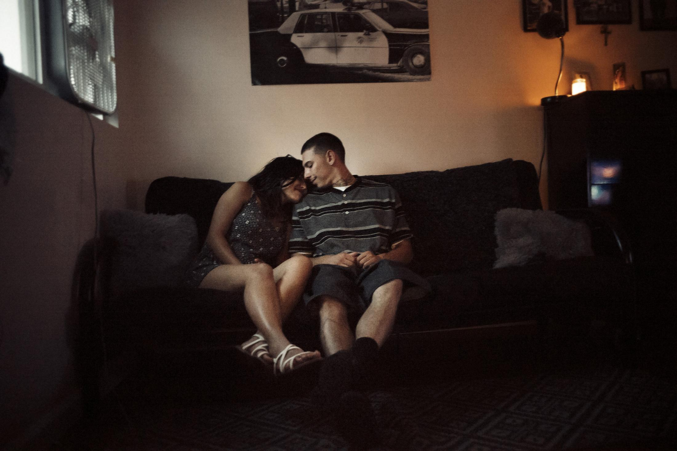 "Marcus Tapia, with his girlfriend Isabel at their shared apartment in East Los Angeles, CA.  Tapia believed that after his good friend ""Yayo"" was gunned down, that he sent Isabel from heaven to keep him on the right path, out of trouble and out of prison."