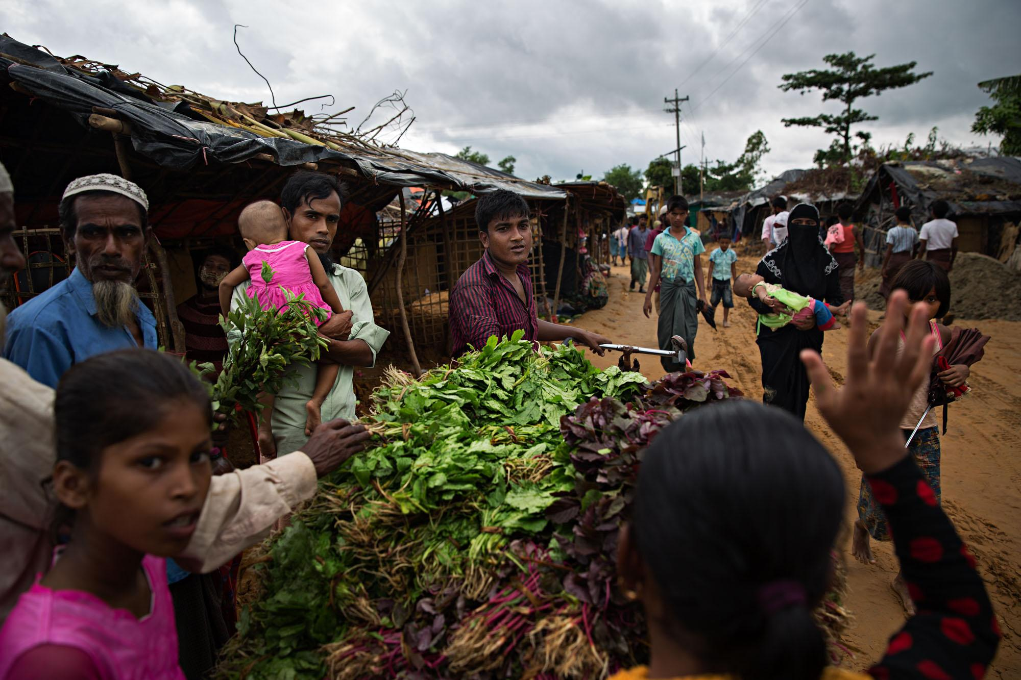 Rohingya refugees sell and buy vegetables in a camp outside of Cox's Bazar, Bangladesh.