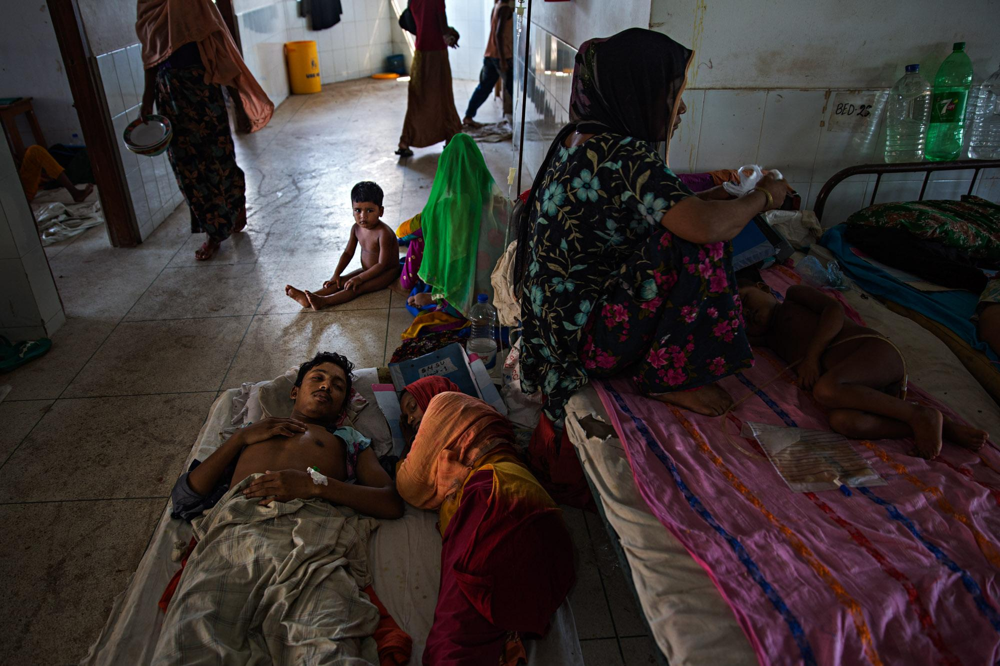 Rohingya refugees find space to sit or rest wherever they can in a hospital in Cox's Bazar. Many suffered from exhaustion or malnutrition, while others suffered from gunshot or knife wounds, burns and worse, not to mention psychological trauma.