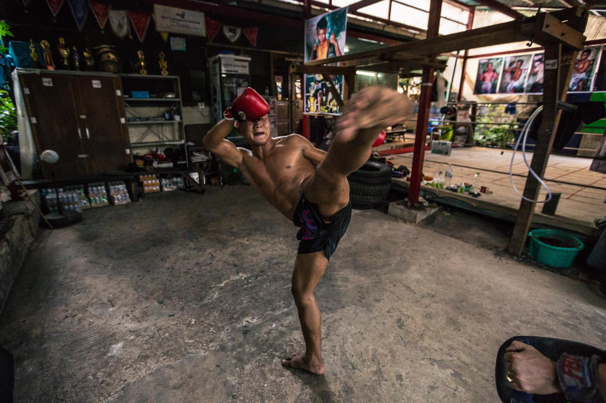 Shan Ko, a professional let wei (Burmese boxing) fighter, trains at Thut Ti boxing gym in Yangon, Myanmar.