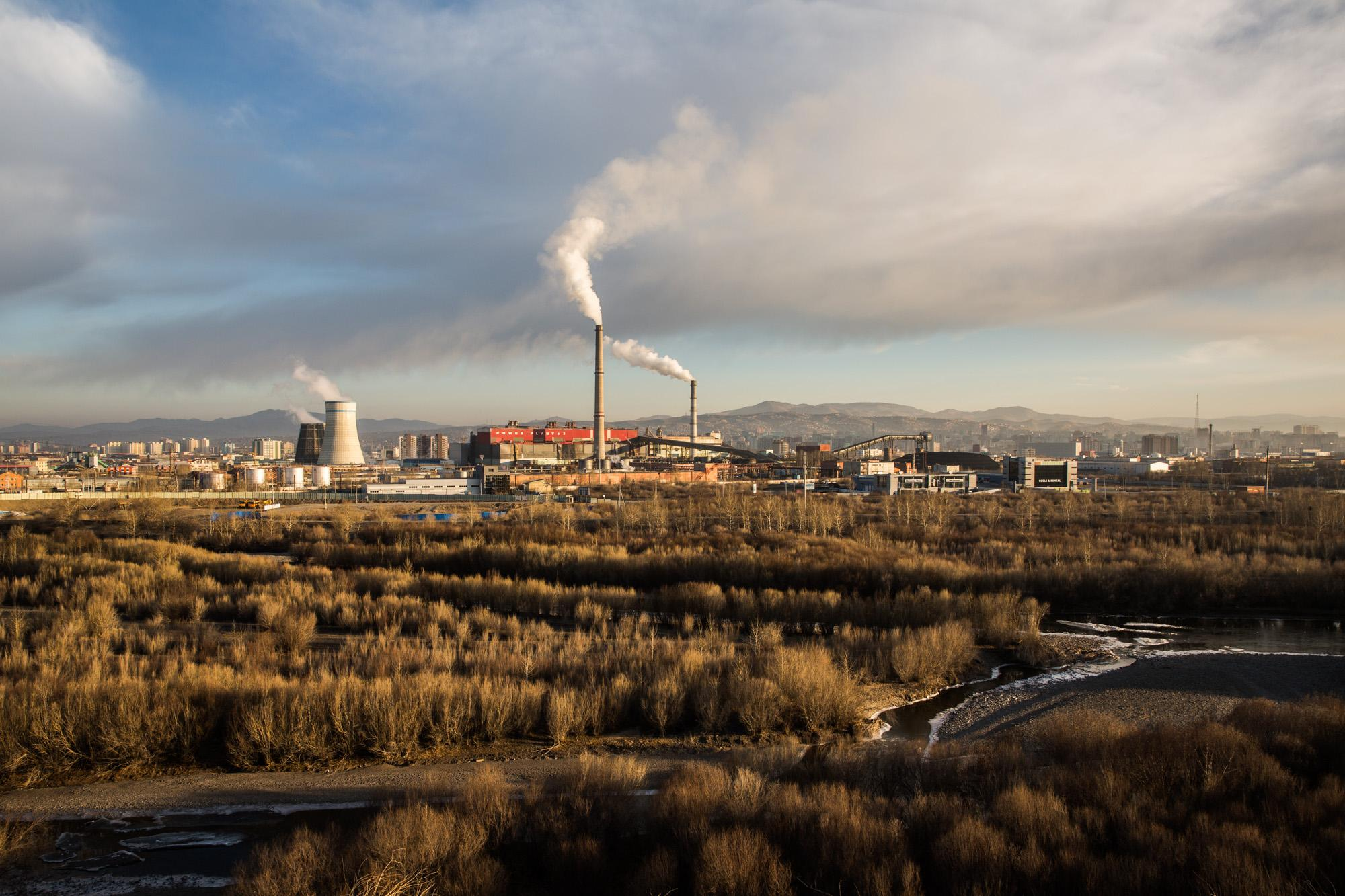 Smoke stacks from a coal-fueled power plant are seen on the edge of Ulaanbataar, Mongolia. During the winter months, when coal usage is at an all time high, including in private homes, the air quality becomes dangerous. Many people, children especially, are diagnosed with pneumonia.