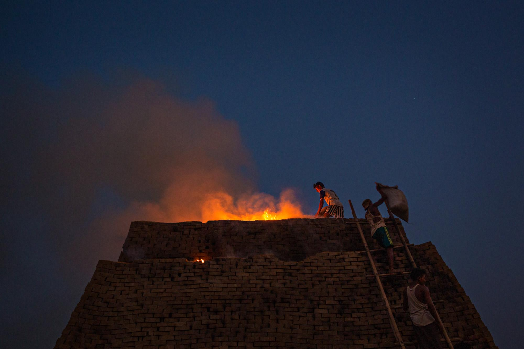A brick kiln burns late into the night on the outskirts of Yangon, Myanmar.