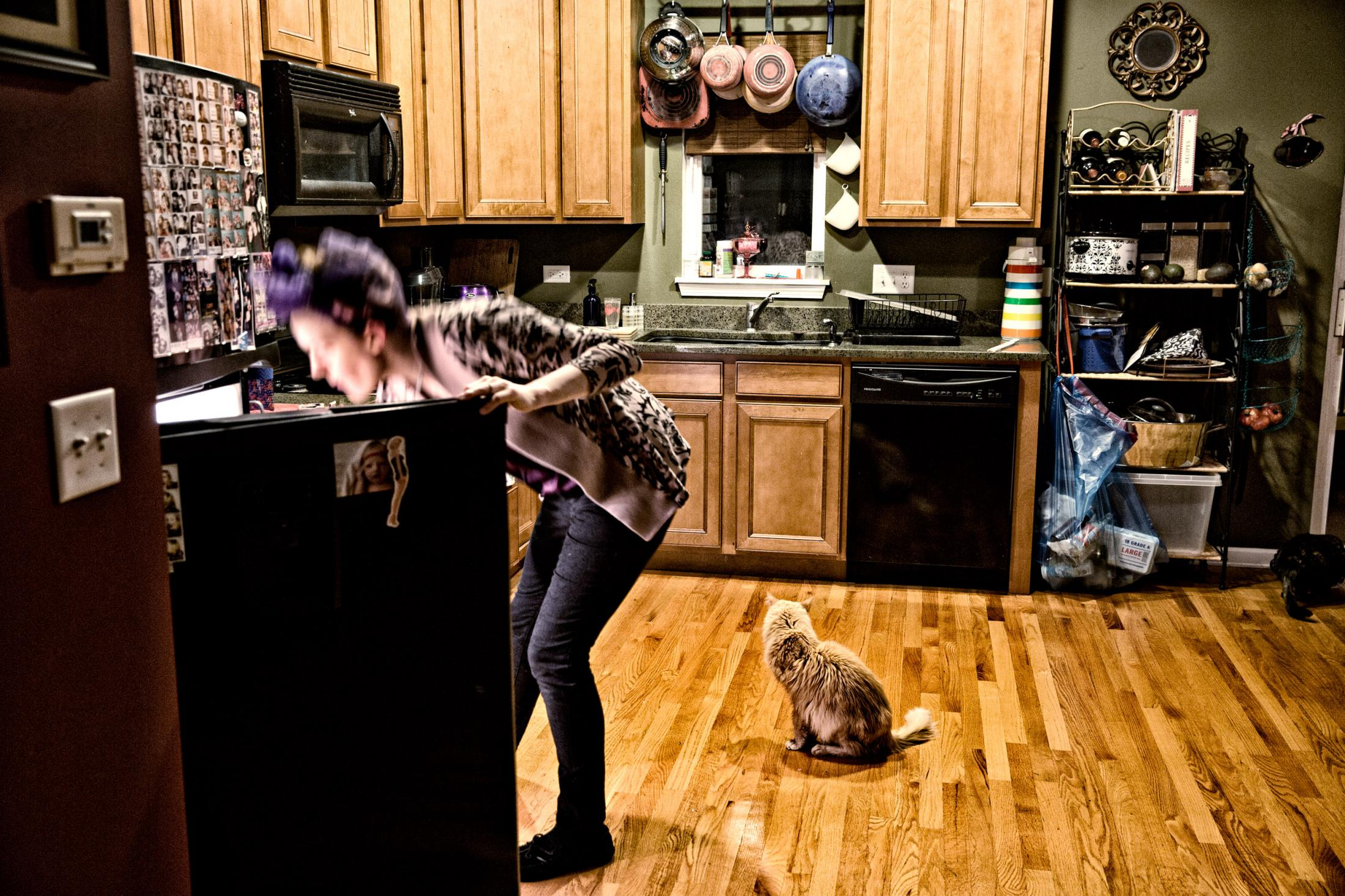 When all is said and done, during a private moment, Annie and her cat look for lunch.