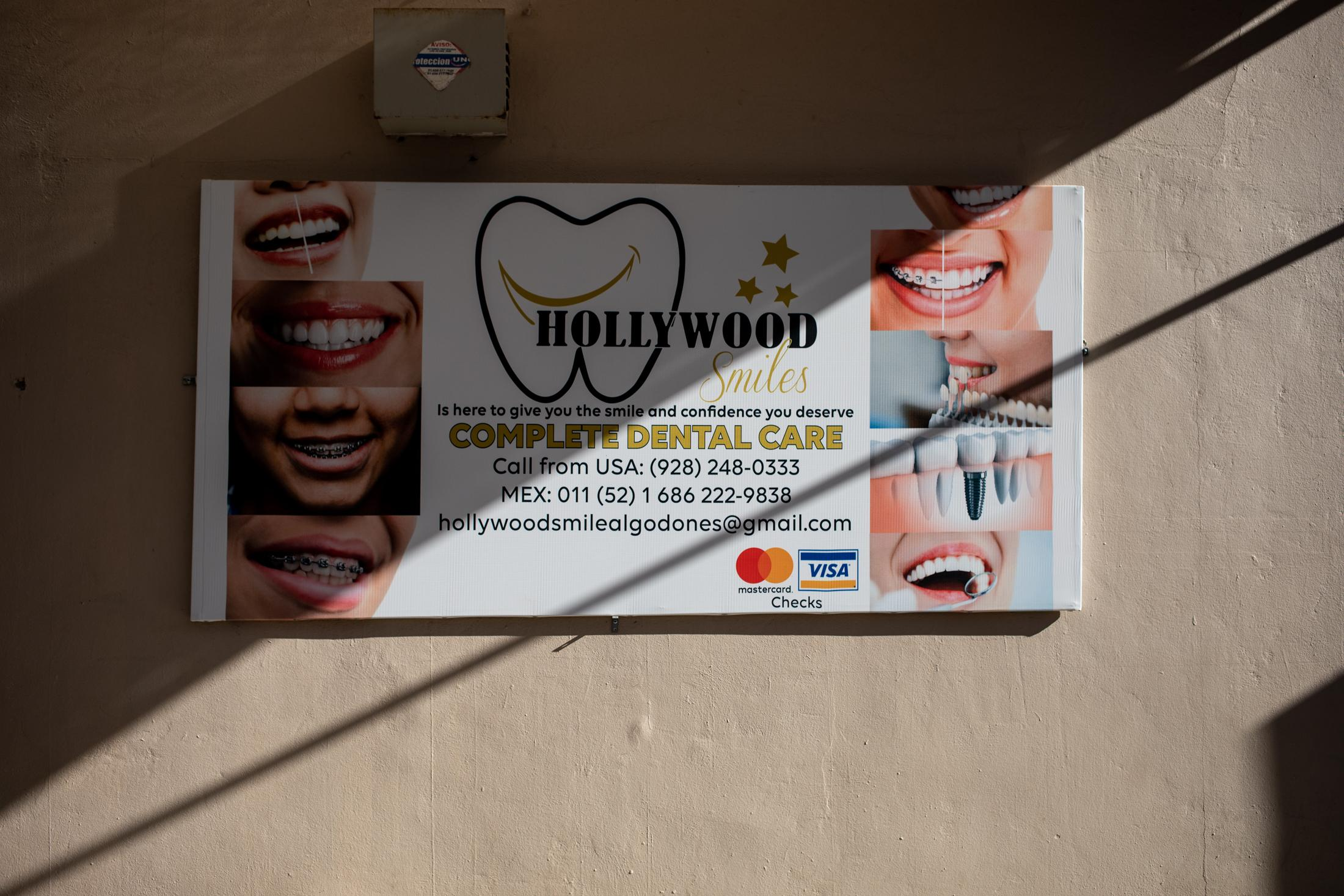 A sign for a dental studio in an alley inside the souvenir market in downtown Los Algodones, Baja California. All around town the streets are covered with signs and billboards for dental clinics, opticians and pharmacies with English instructions. The bigger dental clinics in Los Algodones invest a lot of money every year in marketing.