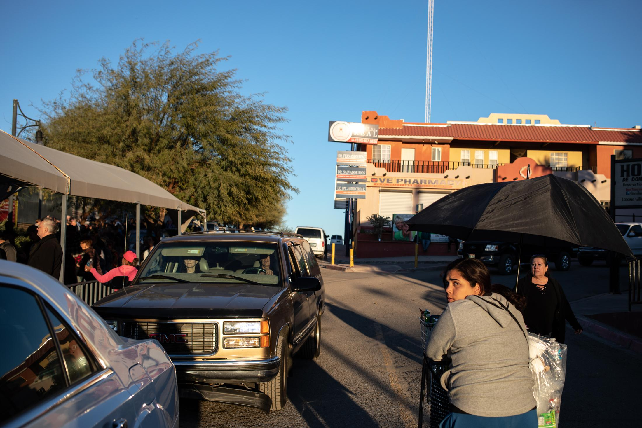 During the long wait in line to cross the border back to the U.S., street vendors sell souvenirs and food.