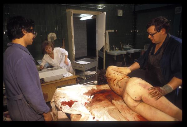 Stabbed to death in a burglary, morticians prepare the body for examination at the city morgue in St Petersburg.