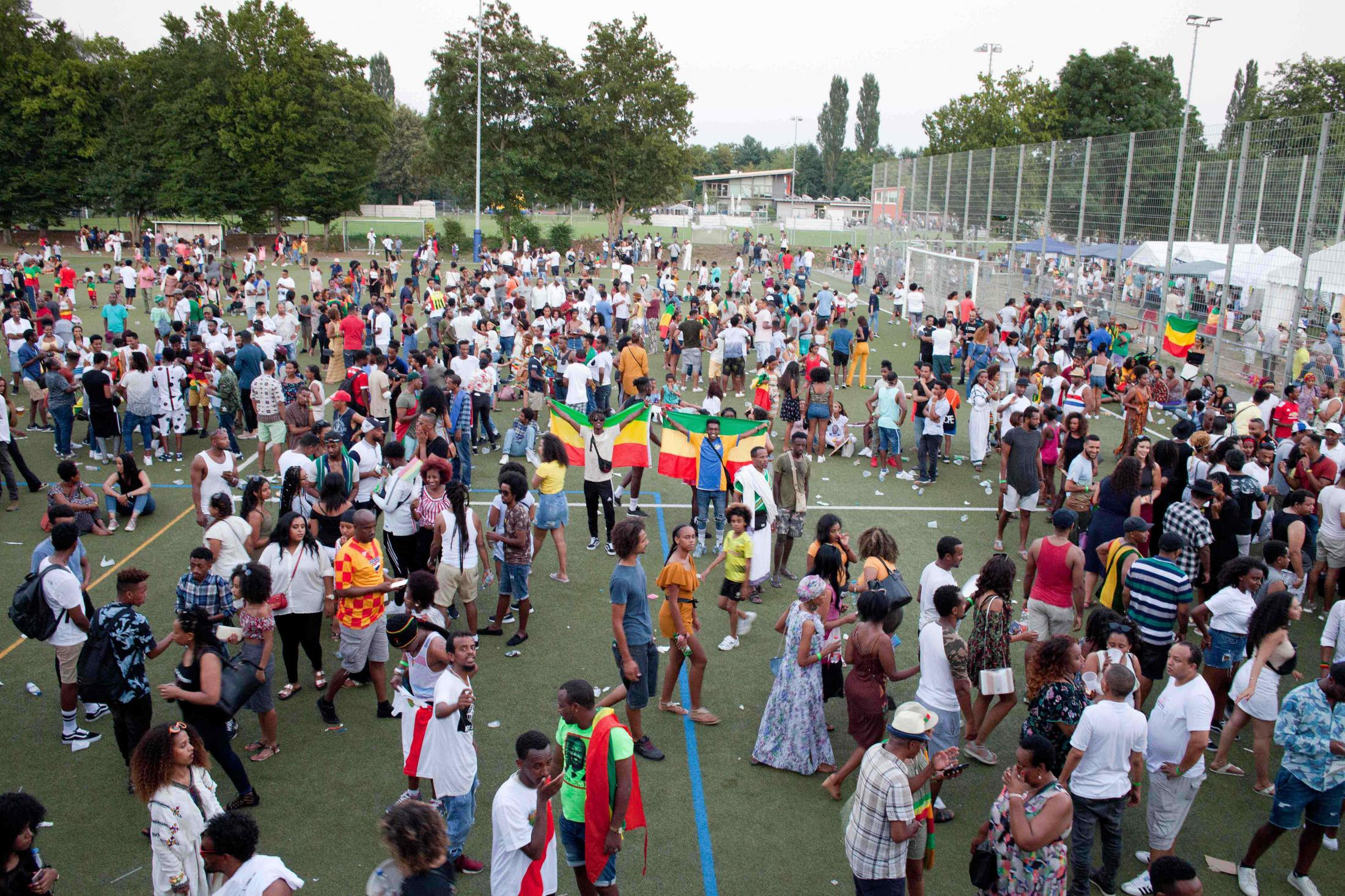 Ze Berlin  players Amsalu and Yeabseru, who both fled Eritrea as minors, hold up the Ethiopian flag during the final party. More than a mere sports event, the football cup is a cultural happening, actively reinforcing family ties within the Habesha diaspora, and fostering a kinship across borders which has yet to manifest between the Ethiopia and Eritrea.