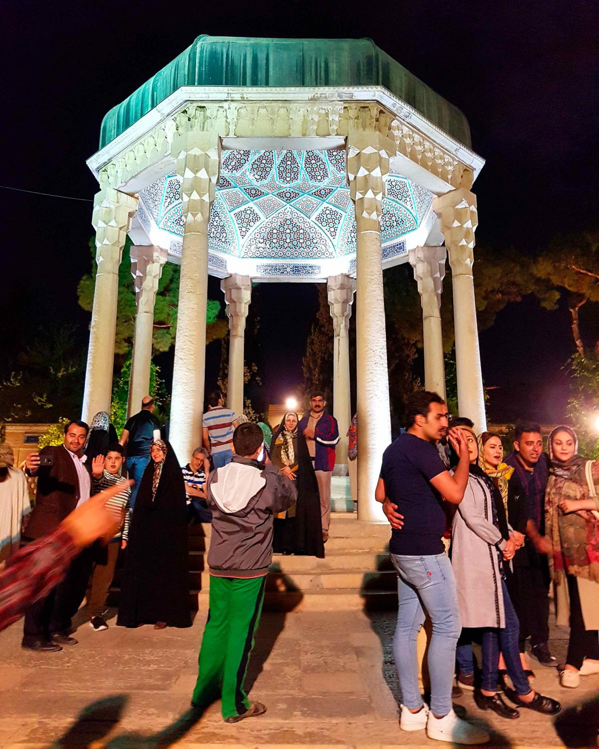 i have never seen anything like this. hundreds of people gather every evening to commemorate the great persian poet hafez. it's like a pilgrimage site for people of all walks of life. agree to disagree, but when it comes to hafez, everyone seems to agree. the #sufi #poet is reverred in and outside of iran for his expression of the joys of love and wine whilst targeting religious hypocrisy. #hafez #tomb #shiraz #wine #love #life