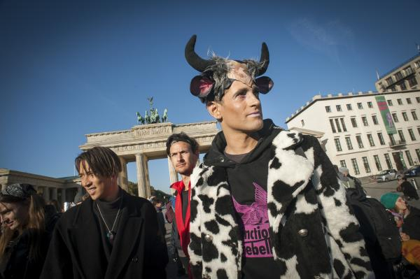 Animal Rebellion under the Umbrella of Extinction Rebellion rally at The Brandenburg Gate before travelling on to The Ministry of Agriculture, Berlin, Germany.
