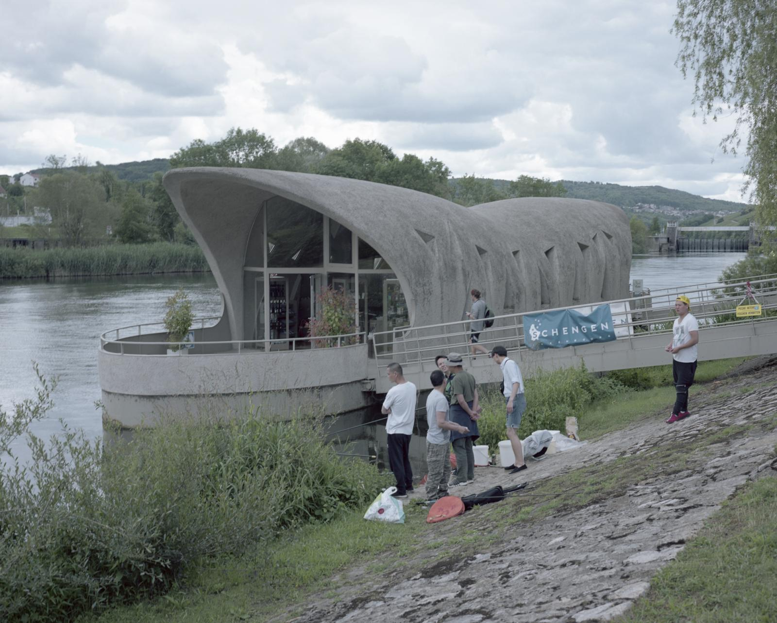 Shengen, Luxemburg. Asians fish nearby the European Museum Information point that celebrate the Shengen Treaty. The Shengen Treaty was one of the goals of the European Union Country consisting in the elimination of the borders within the EU.
