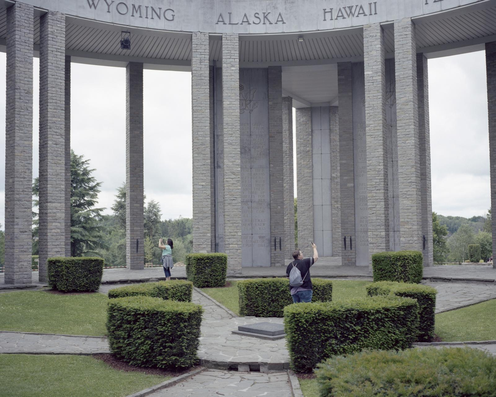Belgium, Bastogne. American tourists shoot picture at the Mardasson Memorial that commemorate the Battle of the Bulge happened during the Second World War in which between 63000 and 98000 German soldiers and 89500 American soldiers were killed, wounded, missing or captured.
