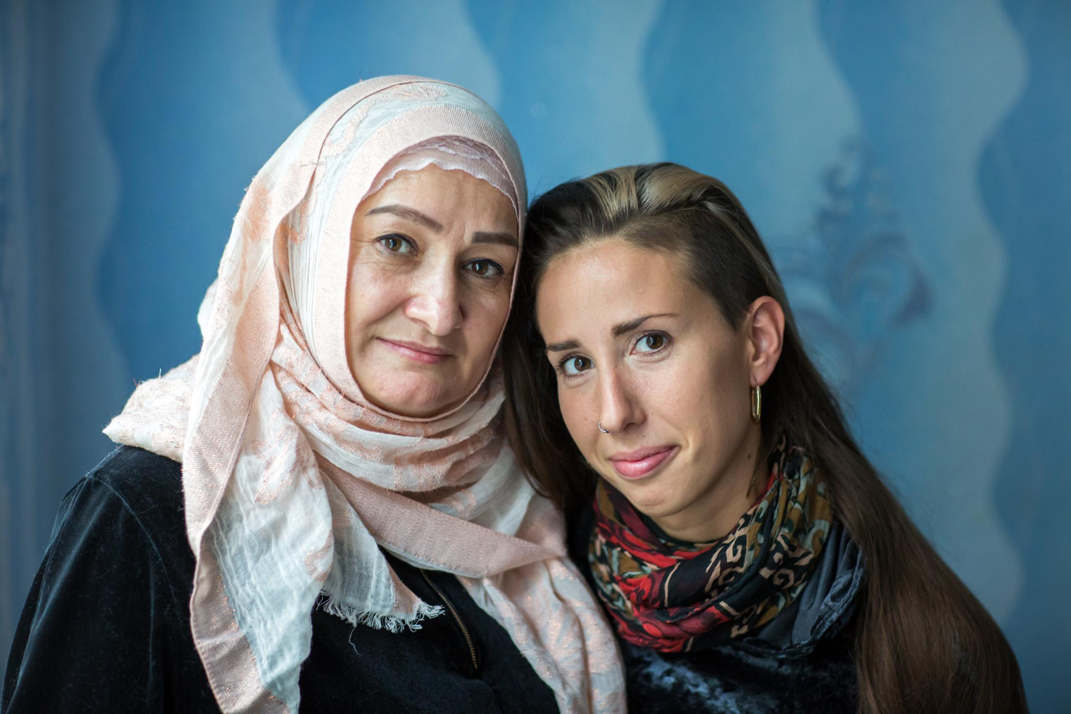 """Khedi is from Chechnya and Jarmila is from Poland. """" I remember your welcome""""- is an art installation with portraits of refugees and the relationships they have made since arriving in Europe. Portrait for Snapshots from the Borders"""