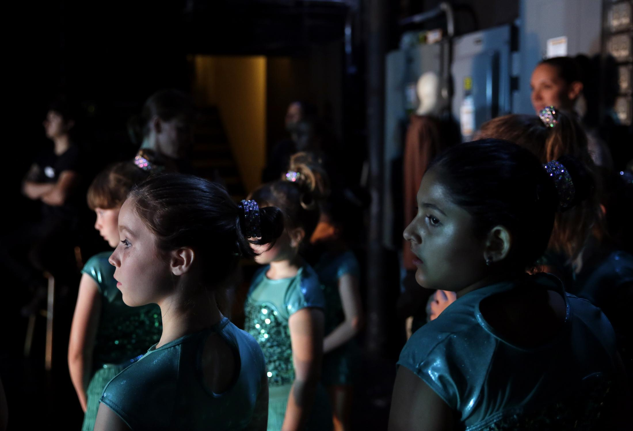 Young dancers watch the performance from backstage during the Dancearts' spring recital May 24 in Jesse Auditorium. Dance Arts turned 40 in 2019.