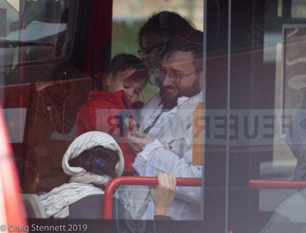 Happy to be safe. A child and other survivors from the Synagogue shooting in Halle (Saale) board a bus at Humbold Strasse and are taken to safety,  Several hours after the assault which killed 2 people and hospitalized several others. Halle (Saale) , Saxony-Anhalt, Germany.   The Lone Gunman who undertook the attacks has since been linked with the Far Right-Neo-Nazis scene with in Germany.